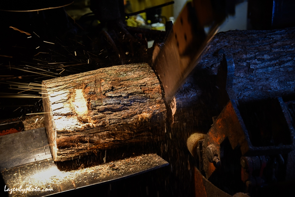 log being cut into cord wood in the wood processor.
