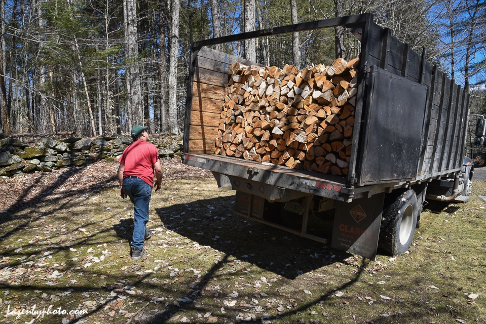 Hector Chaloux prepares to dump a load of cord wood at a residence in Montpelier.