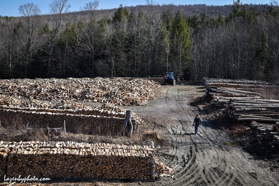 Roger Chaloux walks in wood yard behind his house in Williamstown, VT.