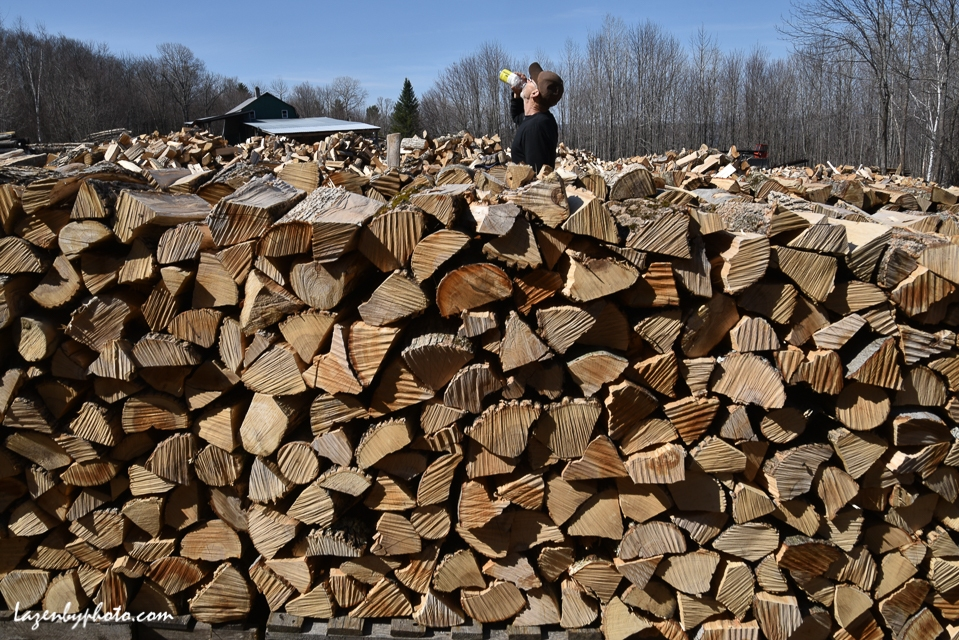 Roger Chaloux taking a break after stacking wood.