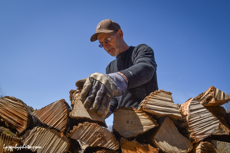 Roger Chaloux stacks wood.