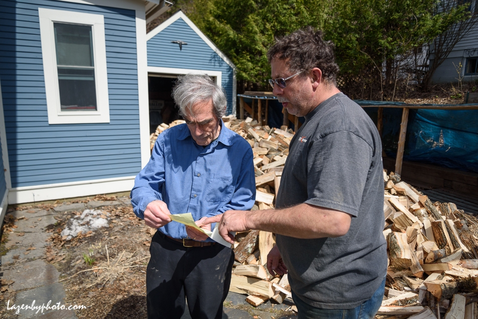 Hector Chaloux (right) with customer afater delivering wood in Montpelier.