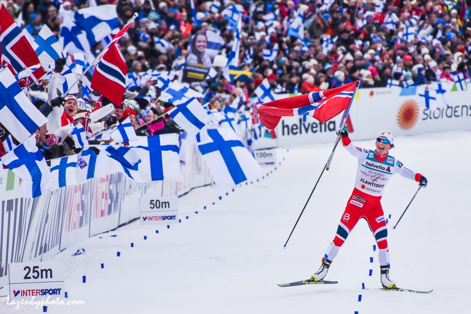 Marit Bjørgen carries the Norwegian flag across the finish line as Norway wins the women's 4-by-5-kilometer relay at the 2017 Nordic World Championships in Lahti. It was Norway's 100th world championship medal.