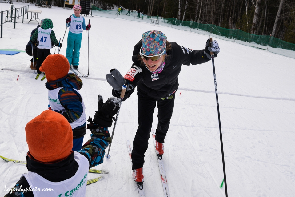 World Cup USST skier Ida Sargent, home for the holidays and the Tour de Ski break, high fives a BKL lollipoper after the lollipop run. NENSA Eastern Cup, COC. VT.