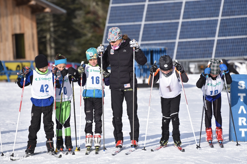 World Cup USST skier Ida Sargent, home for the holidays and the Tour de Ski break, on the start line with BKL skiers, Craftsbury Outdoor Center, VT, NENSA Eastern Cup.