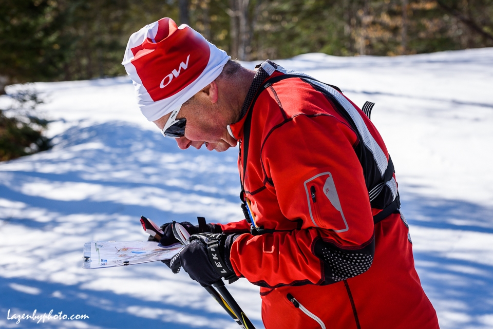 Competitor studies his map, mid-race, in the middle distance race, International Orienteering Federation World Masters Championship, Middle 1, Craftsbury Outdoor Center, Craftsbury, VT.