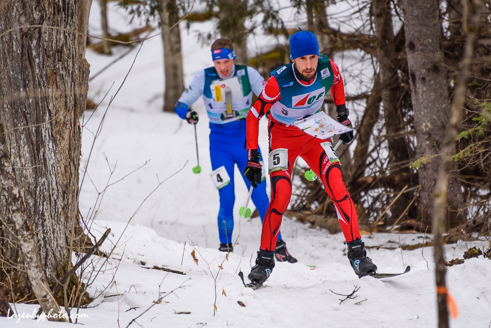 Simon Suciu, Romania, leads Estonian Kevin Hallop in the middle distance race at the International Orienteering Federation World Cup, Craftsbury, VT.