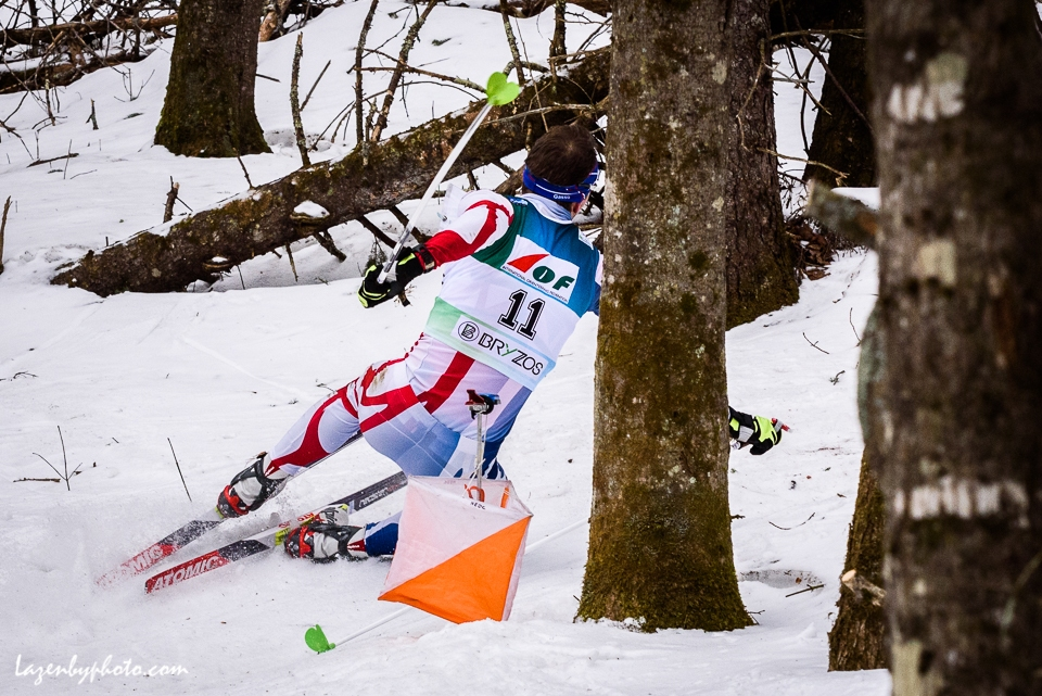 Czech competitor hits a checkpoint and the snow in the middle distance race at the International Orienteering Federation World Cup at Craftsbury Outdoor Center, Craftsbury, VT.