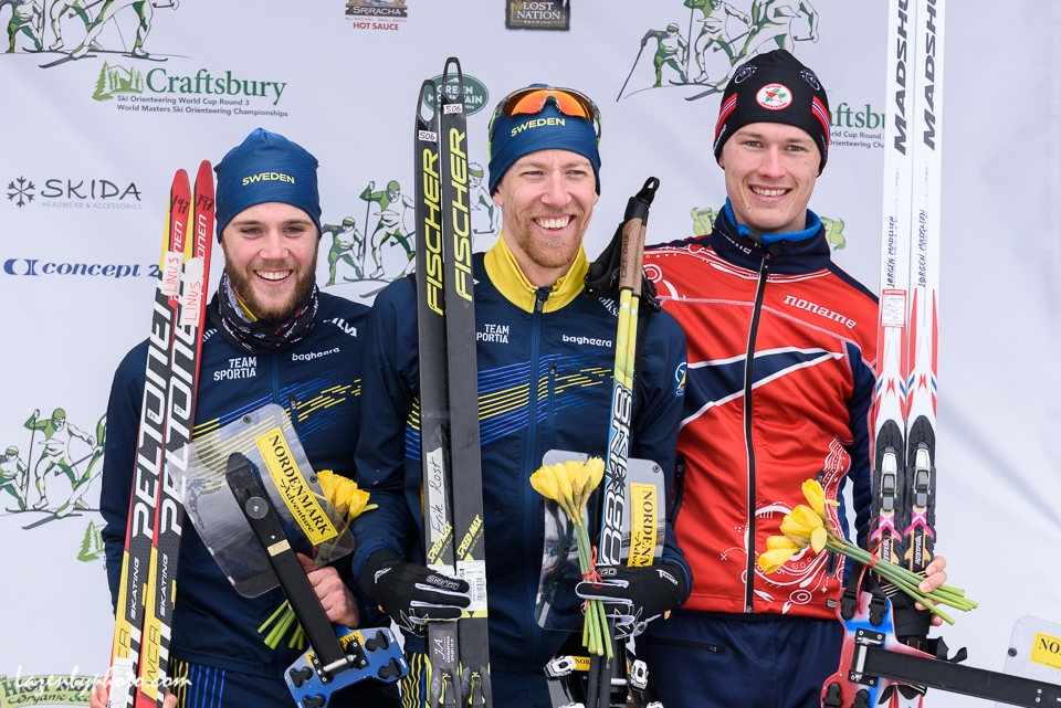 Erik Rost (SWE), center, after winning Ski Orienteering World Cup Middle. Left, 2nd, Linus Rapp (SWE); right, Jorgen Madslien (NOR), 3rd.