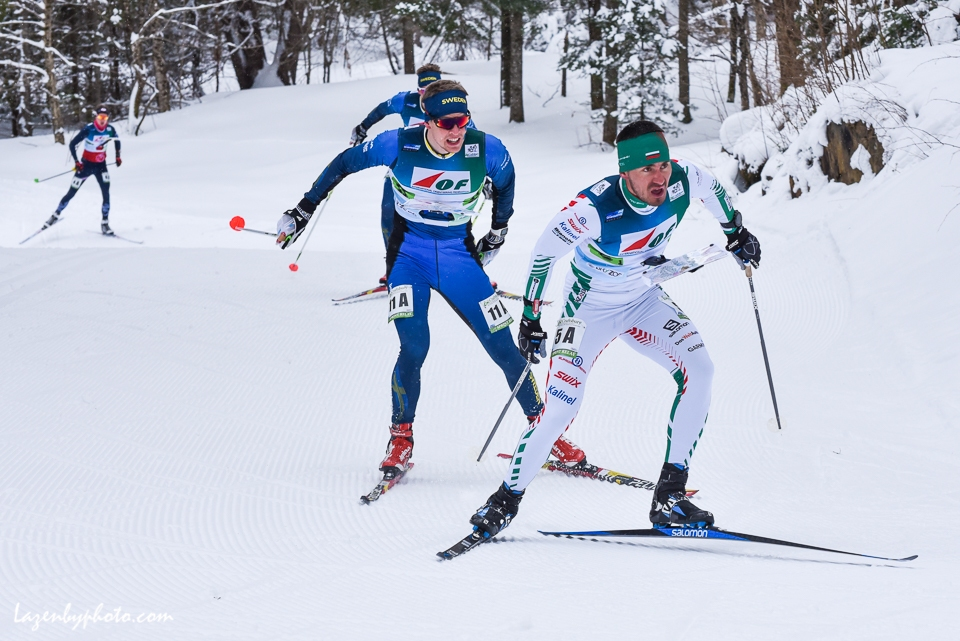 Bulgaria's Stanimir Belomazhev leads Sweden's Oyvind Wiggen in the mixed relay at the at the International Orienteering Federation World Cup at Craftsbury Outdoor Center, Craftsbury, VT.