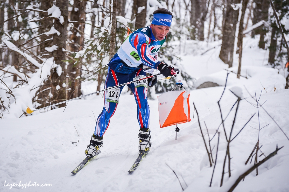 The eventual silver medalist Russian Eduard Khrennikov hits a checkpoint  in the mixed relay at the at the International Orienteering Federation World Cup at Craftsbury Outdoor Center, Craftsbury, VT. He teamed with Tatyana Oborina.