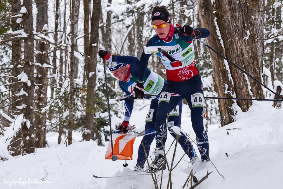 A near miss as competitors Tero Linnainmaa (FIN) and Jorgen Madslien (NOR) arrive at a check point at the same time in the mixed relay at the International Orienteering Federation World Cup at Craftsbury Outdoor Center, Craftsbury, VT.