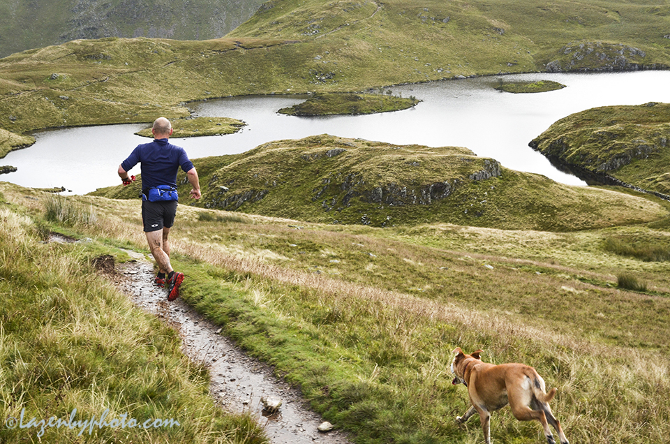 Fell runner, mountain runner; Angle Tarn near Patterdale, Cumbria, England
